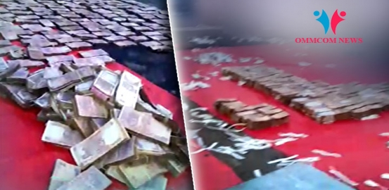 Watch Lakhs Of Drenched Currency Notes Kept To Dry On SBI's Aska Branch Roof