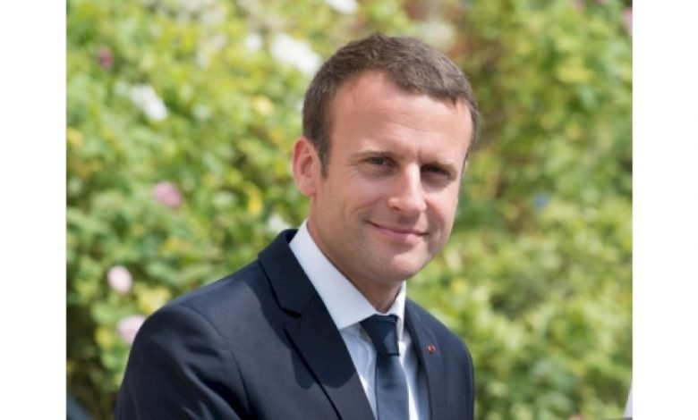 Covid to stay at least until next summer, says Macron